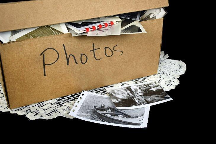 A box of vintage family photos